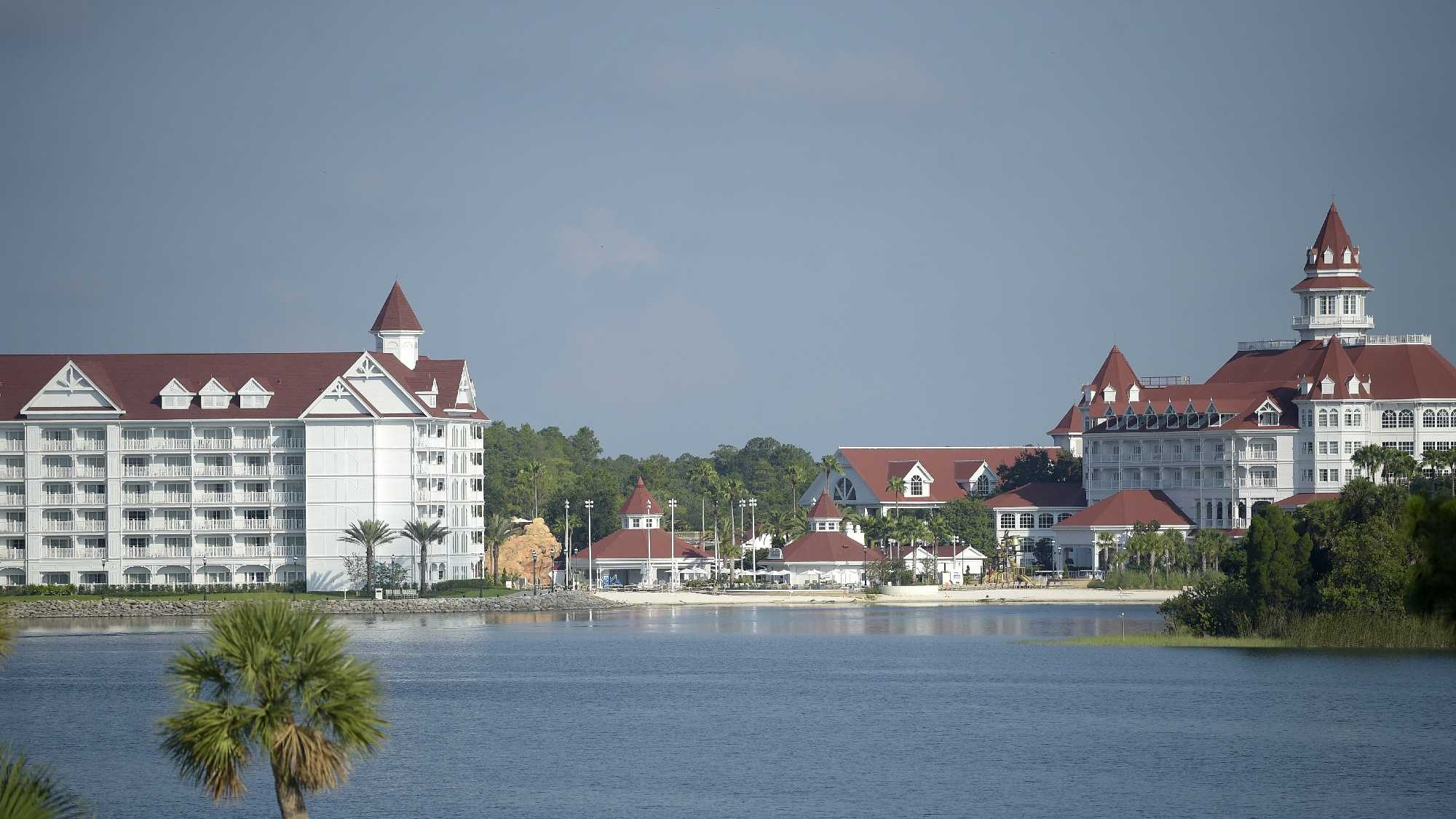 Law enforcement officers search the Seven Seas Lagoon outside Disney's Grand Floridian Resort & Spa Wednesday, June 15, 2016, in Lake Buena Vista, Fla., after a two-year-old toddler was dragged into the lake by an alligator.
