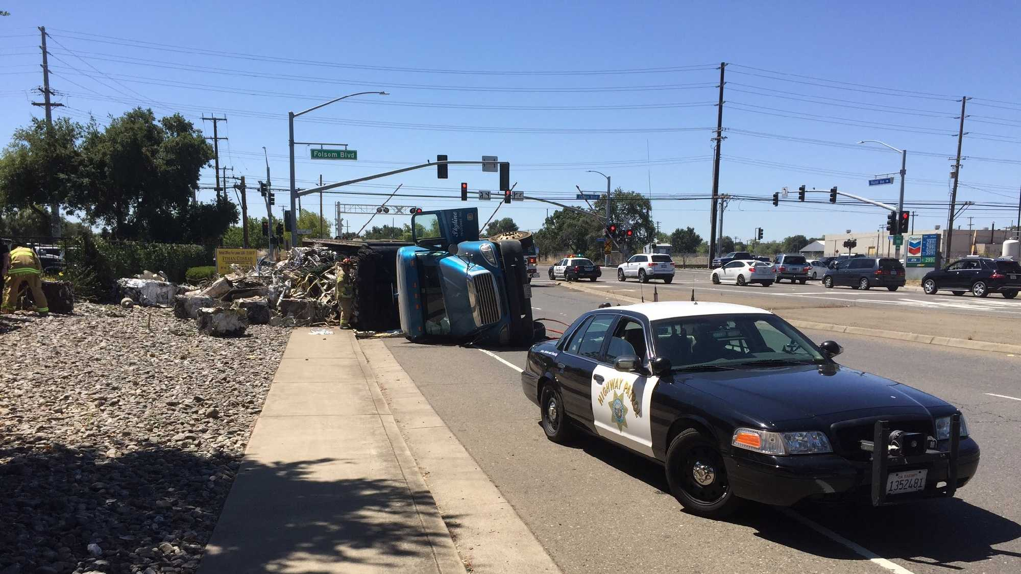 CHP cleaning up a mess after a big rig full of recycled materials overturns at Hazel Avenue and Folsom Road Saturday.
