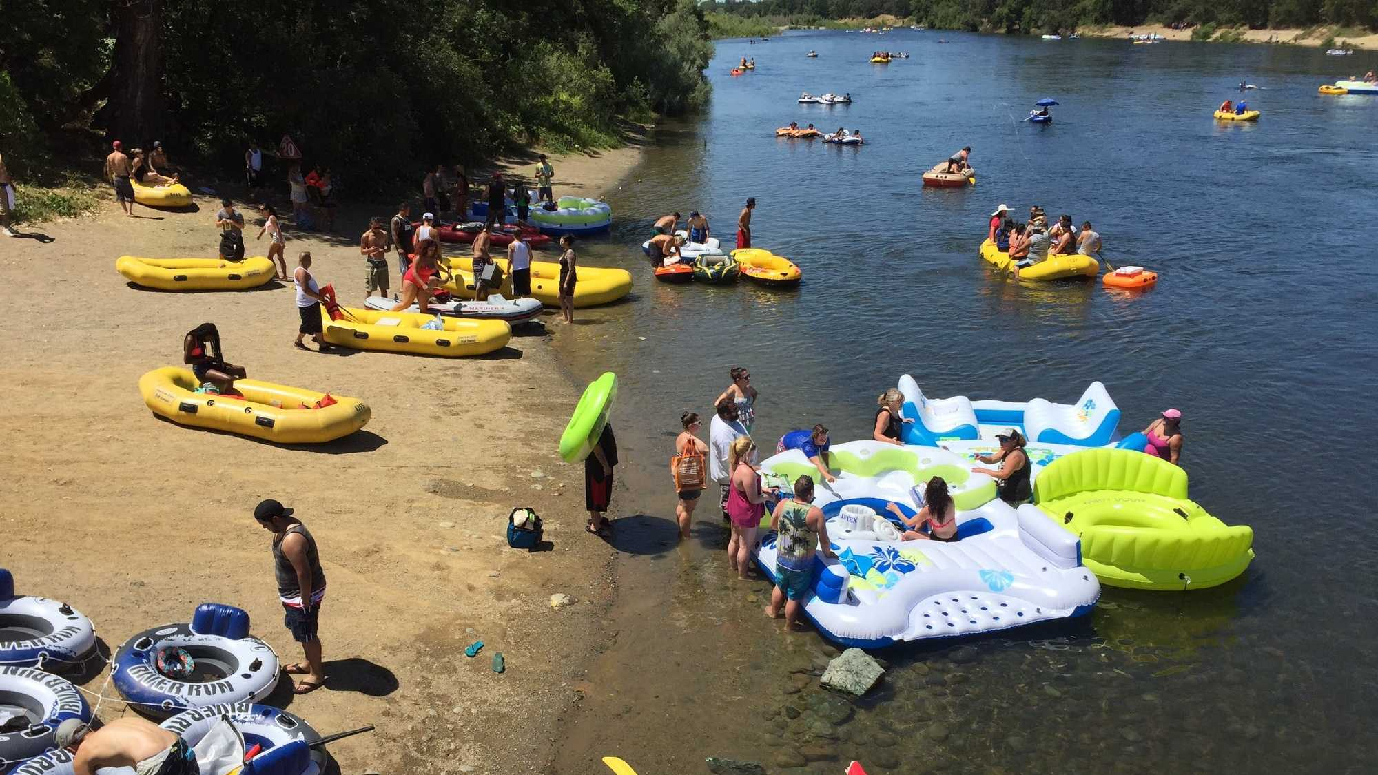 Rafters Gone Wild organizer runs from rangers, jumping into American River.