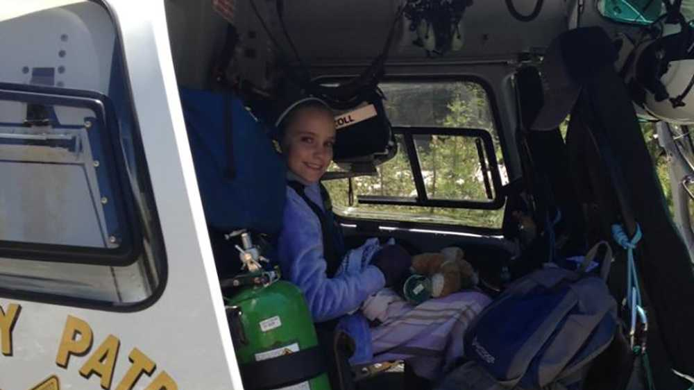 10-year-old Adele safely in the CHP helicopter.
