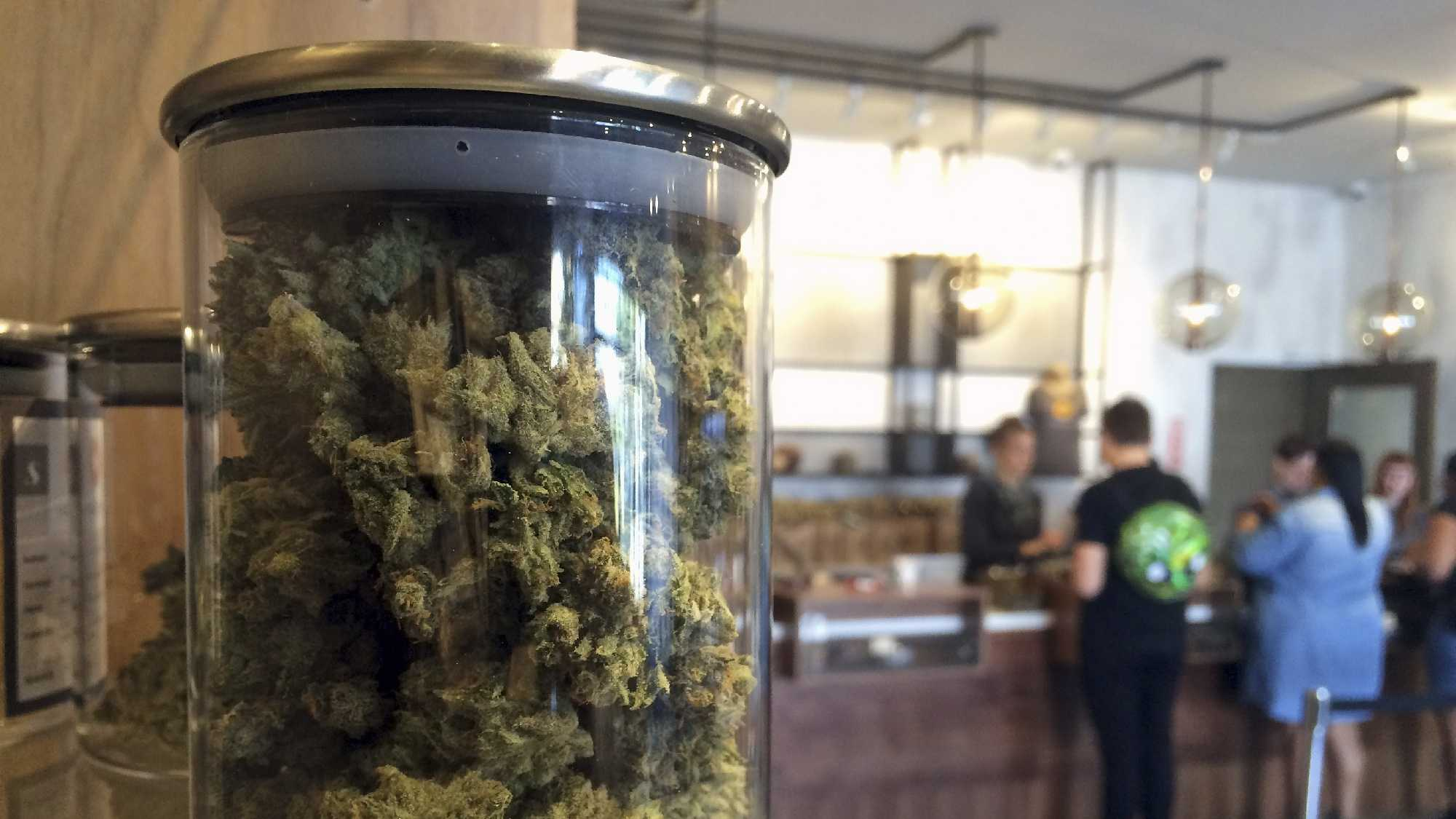 In this April 20, 2016 file photo, customers buy products at the Harvest Medical Marijuana Dispensary in San Francisco.