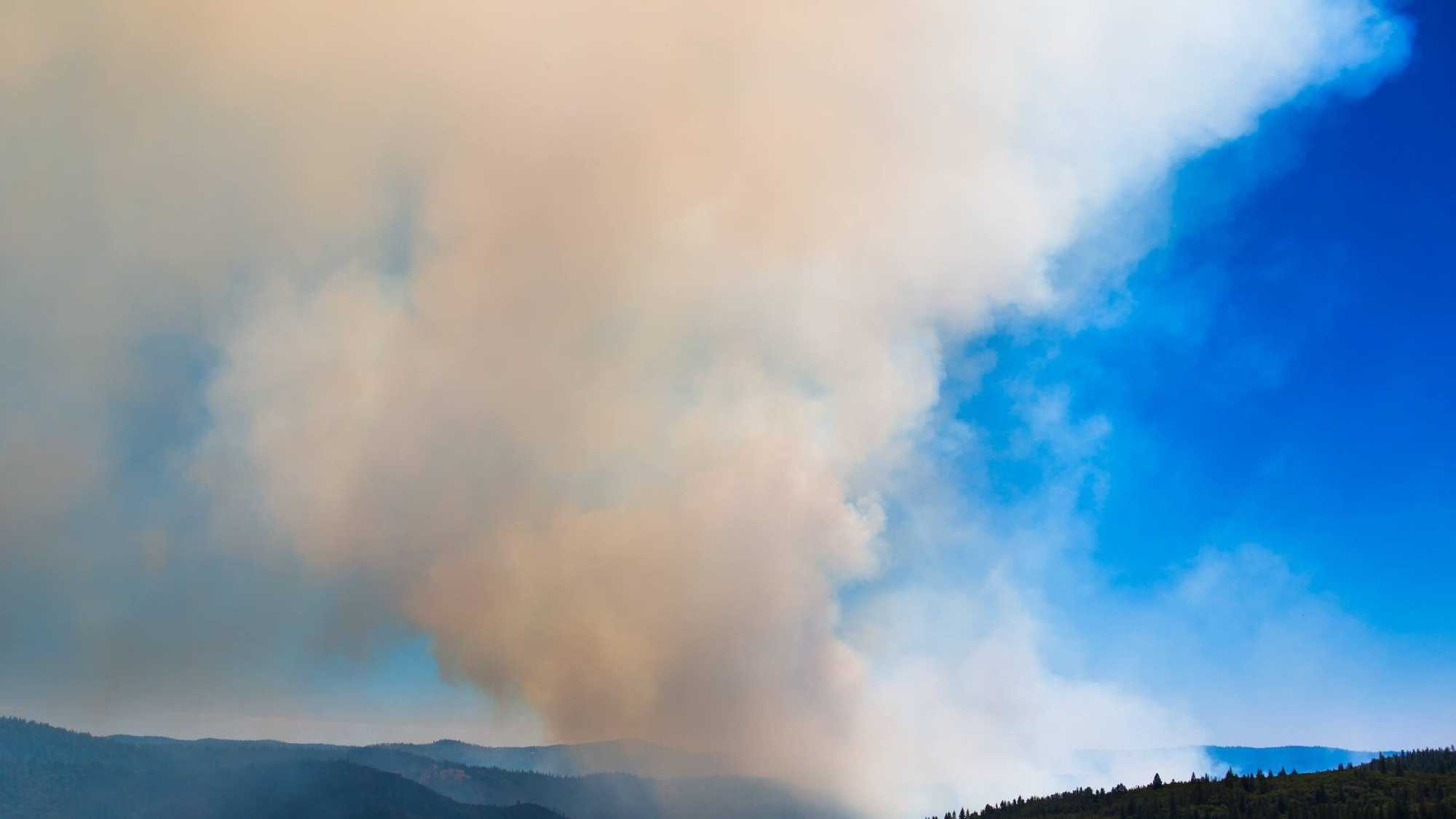 A wildfire burning near Foresthill moved toward Georgetown, expanding to more than 1,500 acres on Thursday, June 30, 2016.