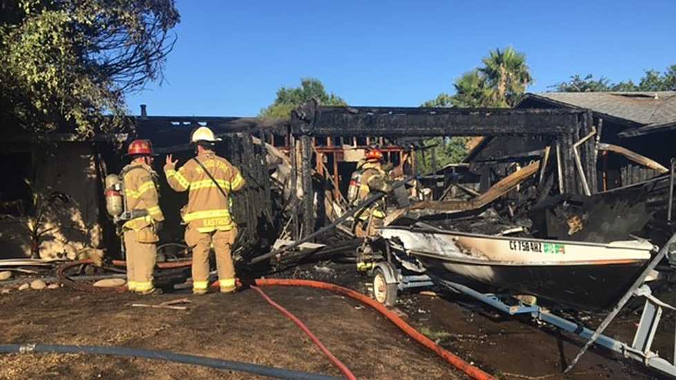 A garage fire spread to a Citrus Heights home and a neighboring home on Friday, July 1, 2016.