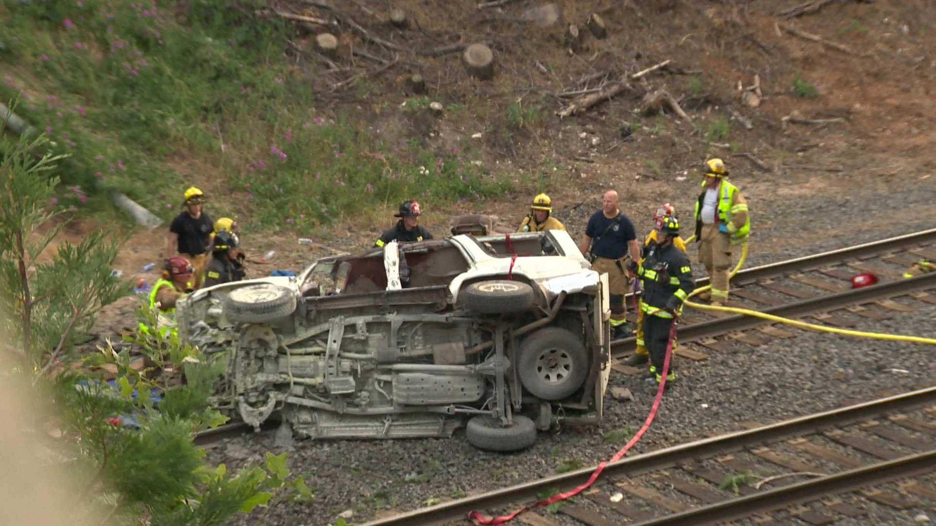 A SUV crashed onto railroad tracks off of Interstate 80, near Alta, in Placer County on July 5, 2016.