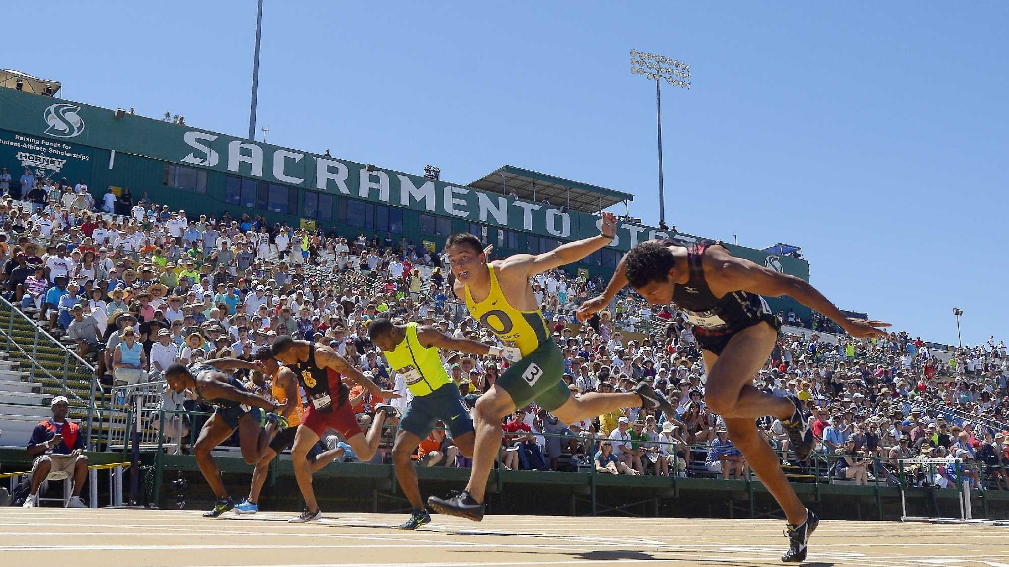Devon Allen, second from right, wins the men's 100-meter hurdles final followed by Ryan Wilson, right, at the U.S. outdoor track and field championships, Sunday, June 29, 2014, in Sacramento, Calif.