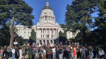 Demonstrators with the Black Lives Matter movement held a rally Friday, July 8, 2016, circling the Capitol multiple times and called for peace and an end to violence.