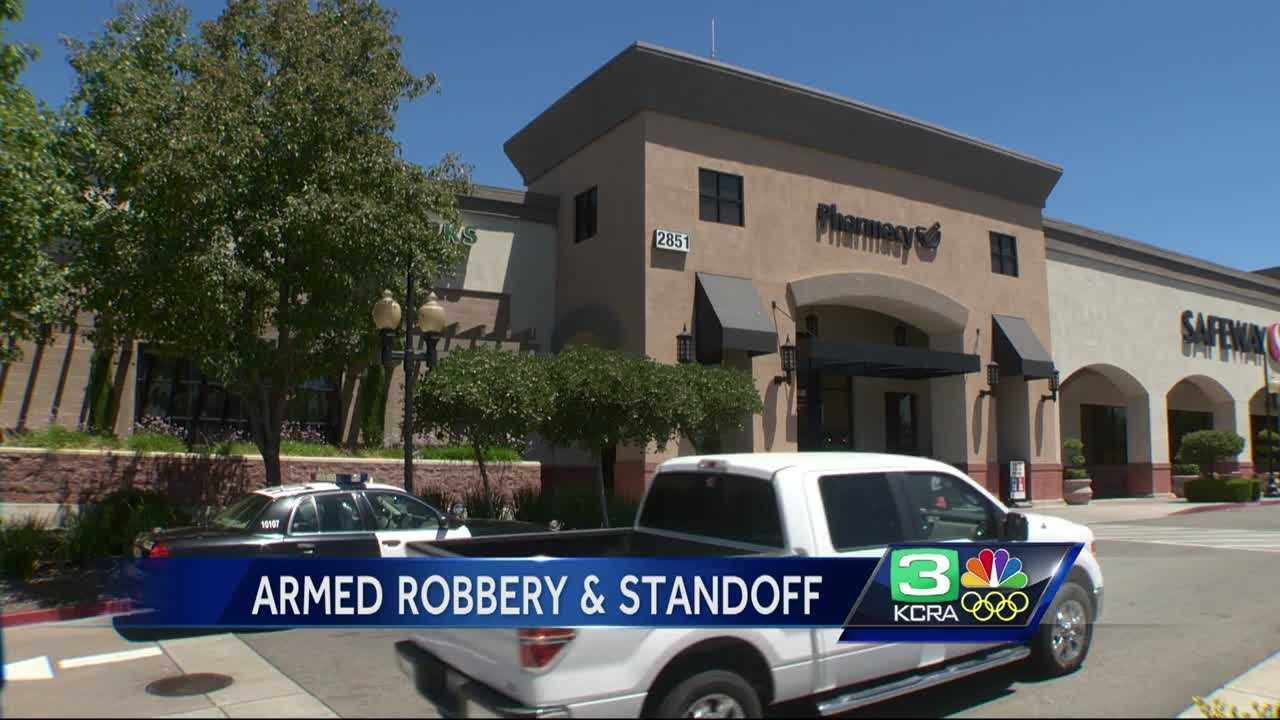 A man and a woman wanted in connection with a bank robbery Sunday in north Sacramento were. Officers say the two suspects turned themselves in peacefully.