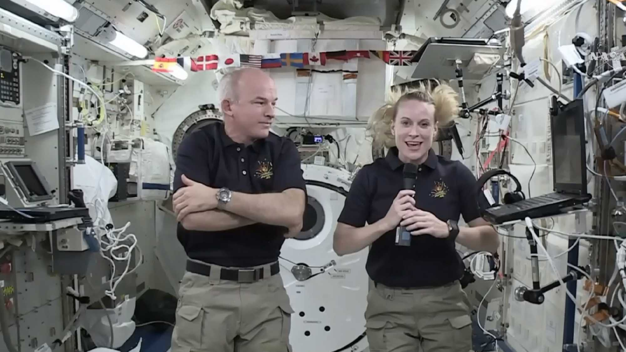 "In this image made from video provided by NASA, astronaut Kate Rubins, right, speaks during an interview aboard the International Space Station on Wednesday, July 13, 2016. At left is Expedition 48 Commander Jeff Williams. Rubins will attempt to complete the first full-blown DNA decoding, or ""sequencing,"" in orbit. The device will be delivered to the International Space Station in the next SpaceX delivery."