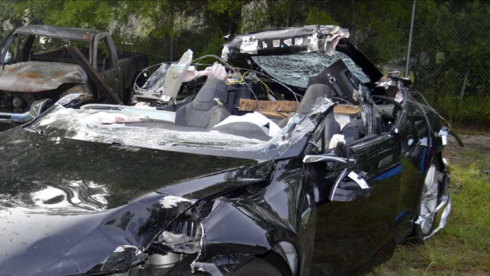 This photo provided by the NTSB via the Florida Highway Patrol shows the Tesla Model S that was being driven by Joshua Brown,who was killed, when the Tesla sedan crashed while in self-driving mode on May 7, 2016.