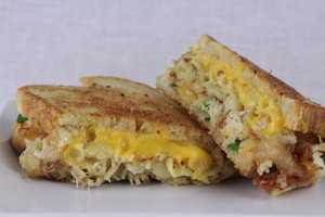 Crab Mac & Cheese Grilled Cheese: This Flavor Face Food Truck sandwich is stuffed with jumbo lump crab, crab chips, scallions and loaded with creamy white cheddar mac & cheese.