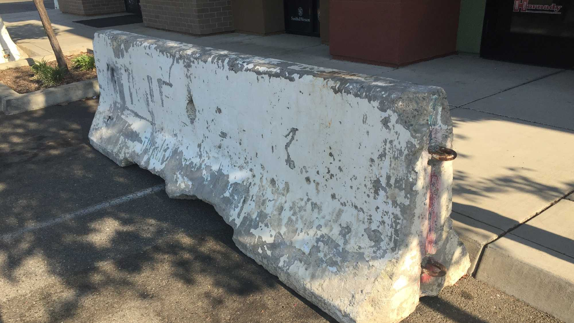 A Rocklin gun store owner put three cement barriers in front of his store and the city is asking him to remove them.