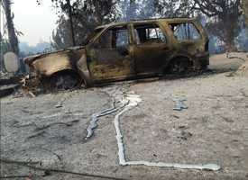 Car rims have been reduced to molten metal as the wildfire swept through the town of Lower Lake's Winchester Street.