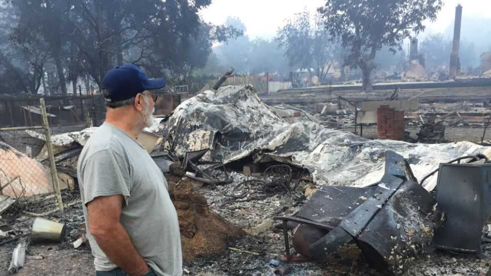 Lower Lake resident Lee Smith surveys his home, which was one of more than 100 homes that were destroyed in the Clayton Fire.