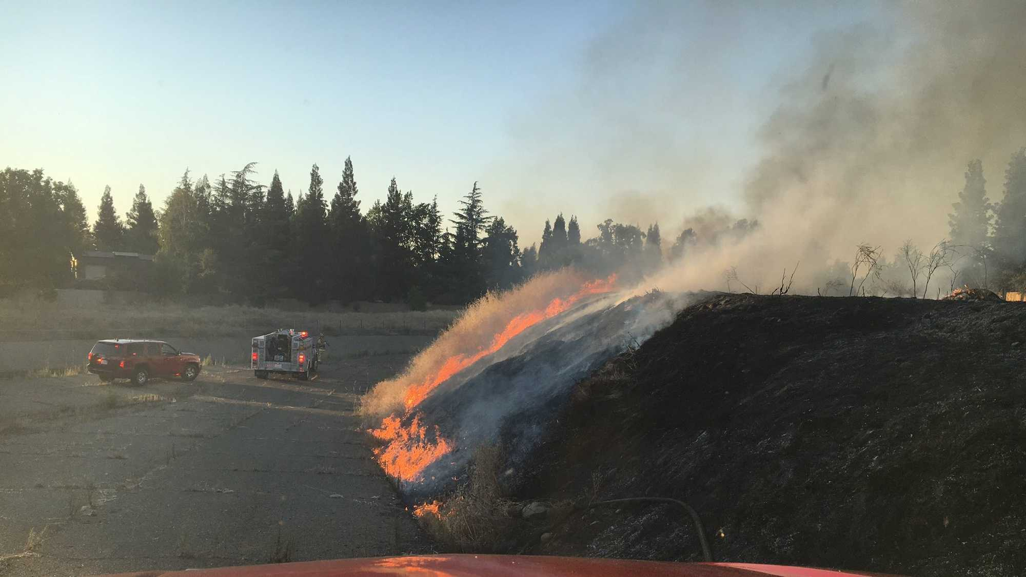 Two grass fires were set Tuesday along Highway 50, west of Hazel Avenue, in Rancho Cordova, the Metro Fire Department said.