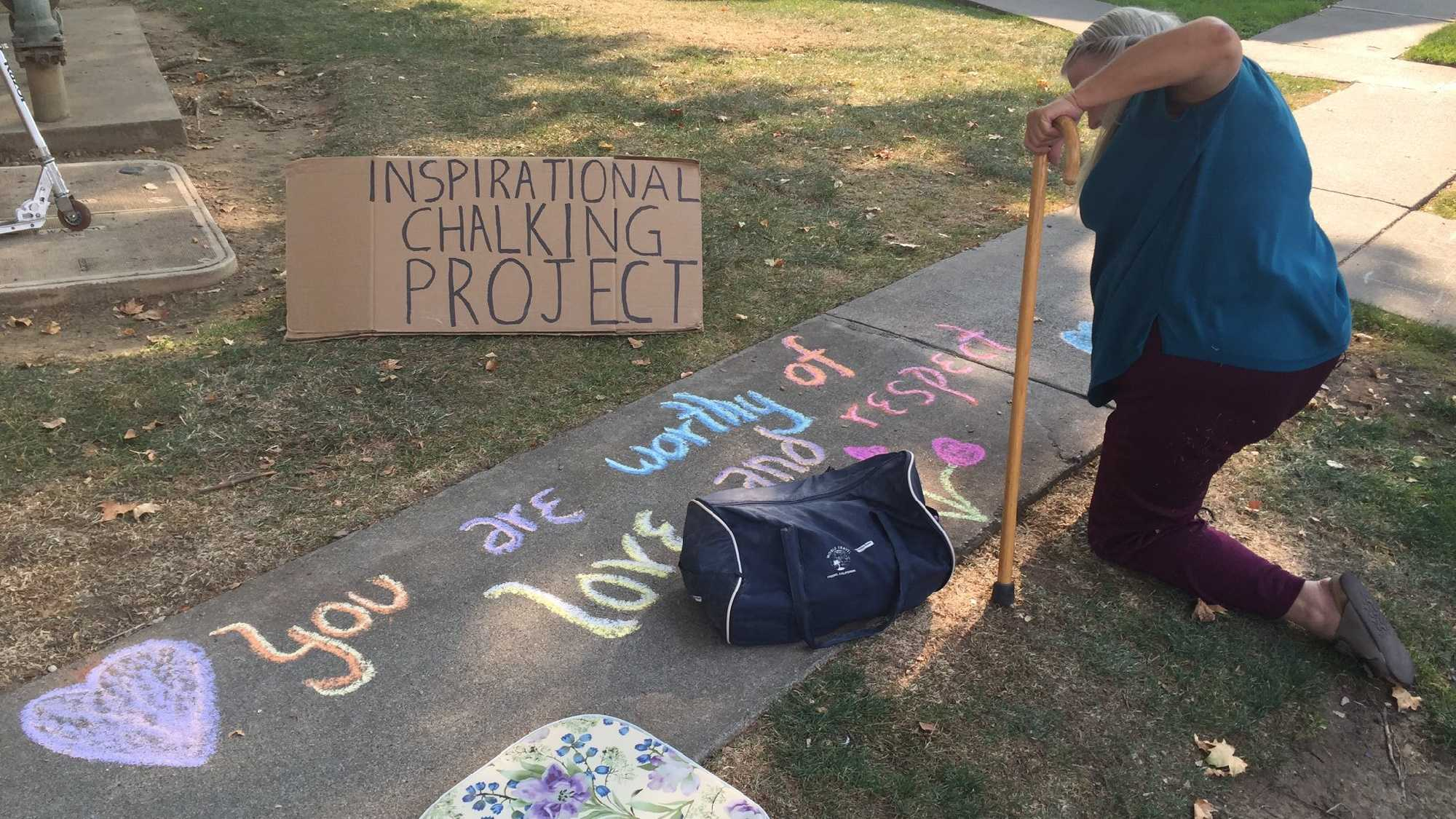Ms. Kay, a 65-year-old retired accountant, draws inspirational messages on Carmichael sidewalks.