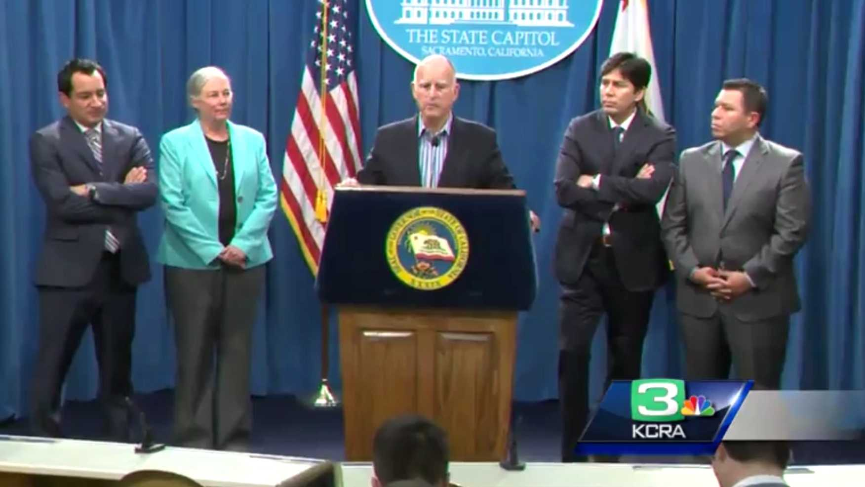 Gov. Jerry Brown was joined by other California lawmakers during a news conference Wednesday, Aug. 24, 2016, as they announced the passage of a bill extending California's landmark climate change law. Brown said when the bill reaches his desk, he will sign it.