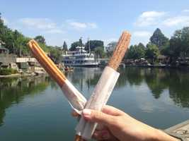 1. Churros: These delicious pastry sticks are hard to pass up on once you walk by a churro stand. The smell will lure you to bite into the sugar-coated fried dough that has become a staple at the Anaheim parks.