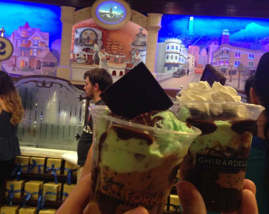 10. Ghiradelli Mint Bliss: For another ice cream option in California Adventure, a visit to the Ghiradelli Soda Fountain and Chocolate Shop is a must. The shop has a fun Gold Rush theme, and they typically give you a sample of their famous chocolate as you walk in the door. However, if you're looking for ice cream, you should definitely try the Mint Bliss. It's a delectable cup of mint chocolate chip and chocolate ice cream laced with hot fudge and topped with whip cream and a chocolate square. Yum!