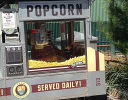 4. Popcorn: Looking for a little snack to hold you over before dinner? Grab some of this buttery goodness. The Disney popcorn stands freshly pop their own kernels, making this popcorn the perfect solution to your midday hunger. Popcorn carts are sprinkled throughout both Disney parks.