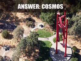 """The 80-foot high, bright-red bronze sculpture is called """"Cosmos."""" It was created by Aris Demetrios in 1990 and dedicated to the people of Roseville by developer Angelo Tsakopoulos."""