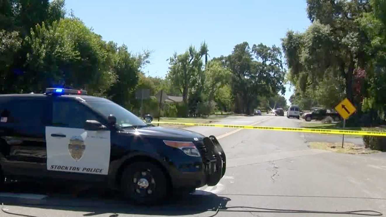 Police investigate a deadly crash involving an 84-year-old woman and two Stockton police officers on Wednesday, Aug. 31, 2016. The woman was pronounced dead at the scene and the officers suffered minor injuries.