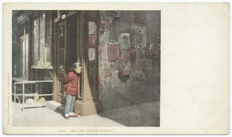 "A postcard of a young boy in Chinatown from the Detroit Publishing Company. ""Are the police coming?"" reads the caption."