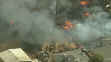 A fire in a south Sacramento neighborhood burned multiple buildings on Tuesday, Sept. 6, 2016. Here aerial photos from LiveCopter 3 of the fire fight: