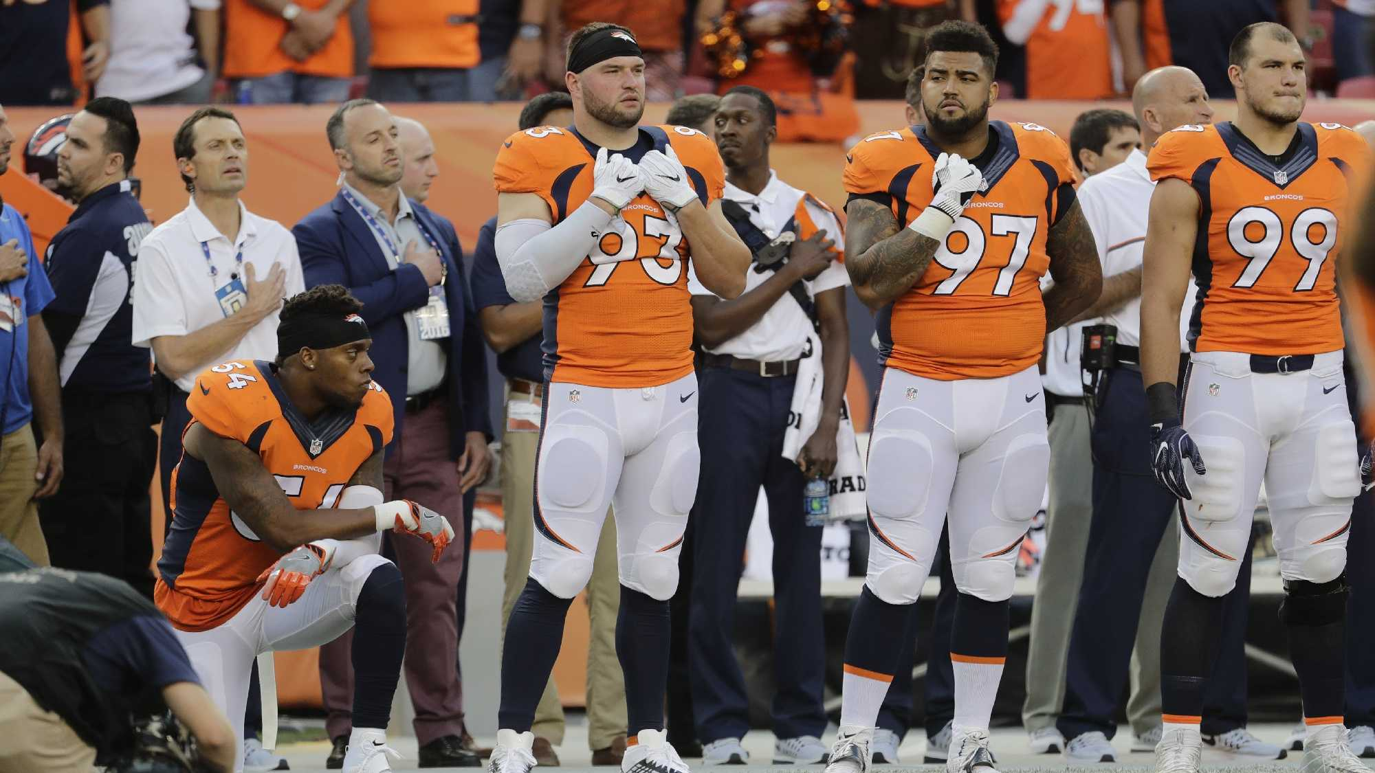 Denver Broncos inside linebacker Brandon Marshall (54) kneels on the sideline during the National Anthem prior to an NFL football game against the Carolina Panthers, Thursday, Sept. 8, 2016, in Denver.