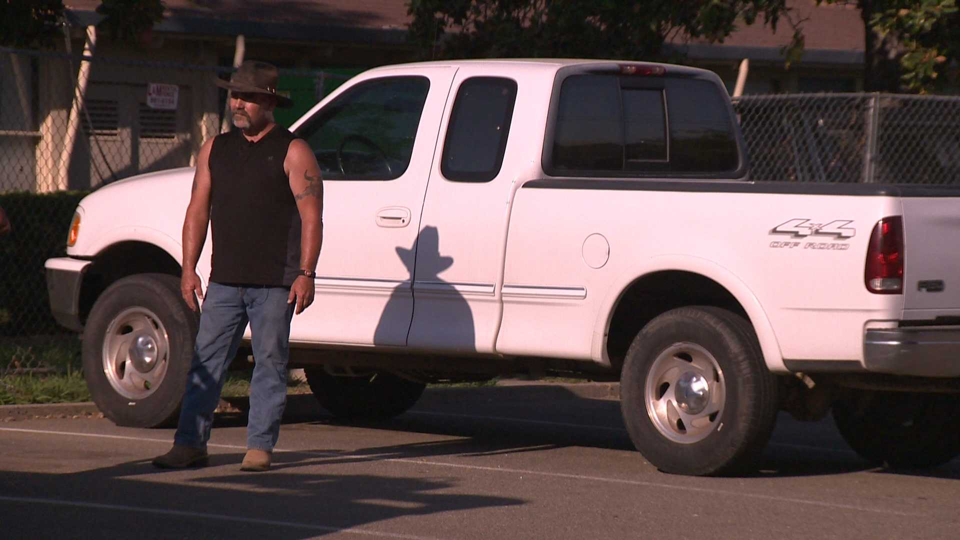 Mark stands in front of his truck, which thieves was broke into and stole his weapons.