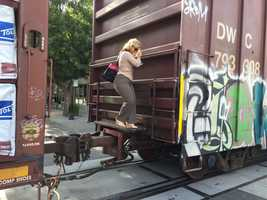 People climbed between train cars to get to workafter it got stuck on the tracks in Midtown Sacramento.