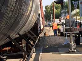 The coupler that once held the BNSF train together is laying next to the train.