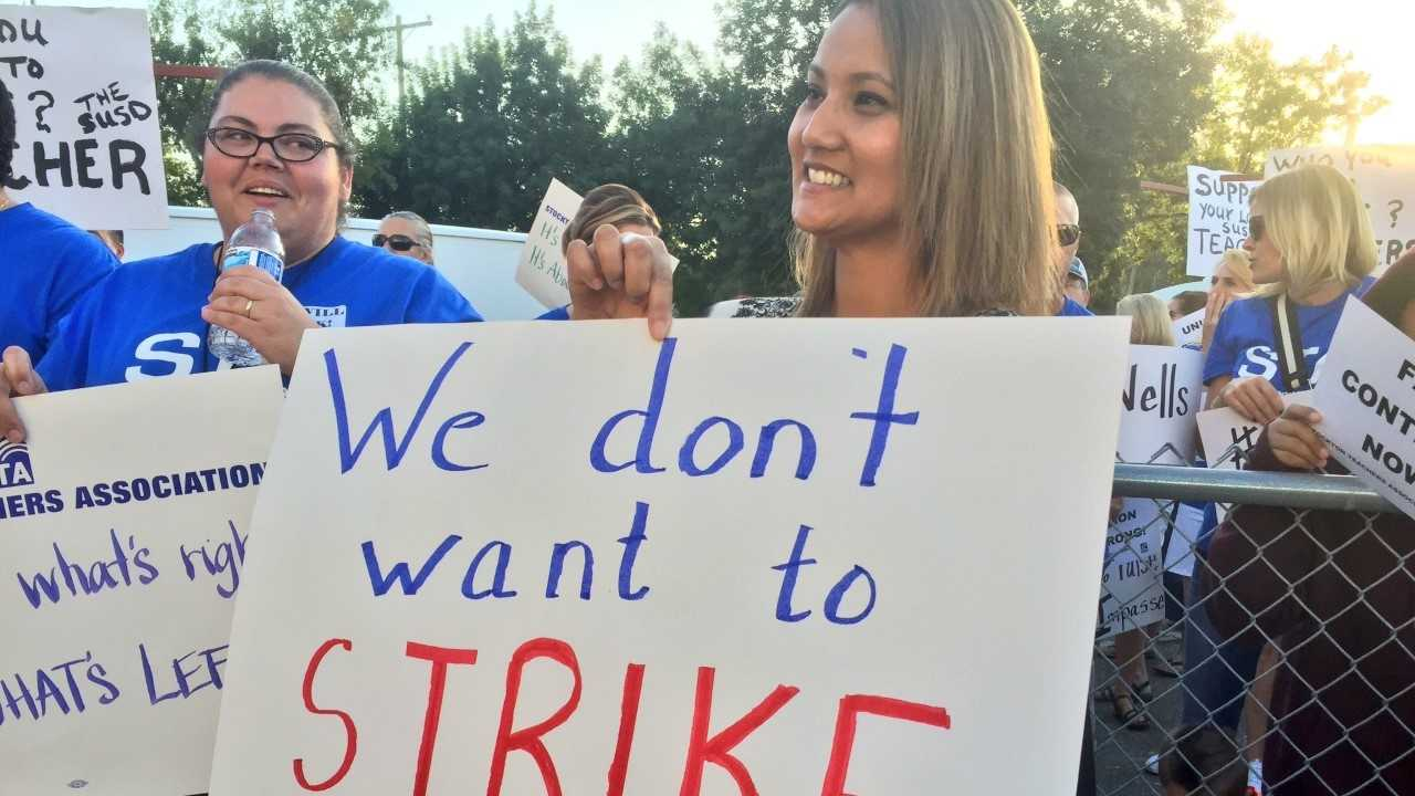 Stockton teachers rally outside of school district offices on Tuesday, Sept. 16, 2016, promising to strike if the school board doesn't meet their wage demands.