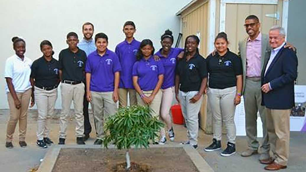 Sacramento Kevin Johnson poses with Sacramento Charter High School students before the Seeds of HOPE Harvest Dinner on Wednesday, Sept. 22, 2016.