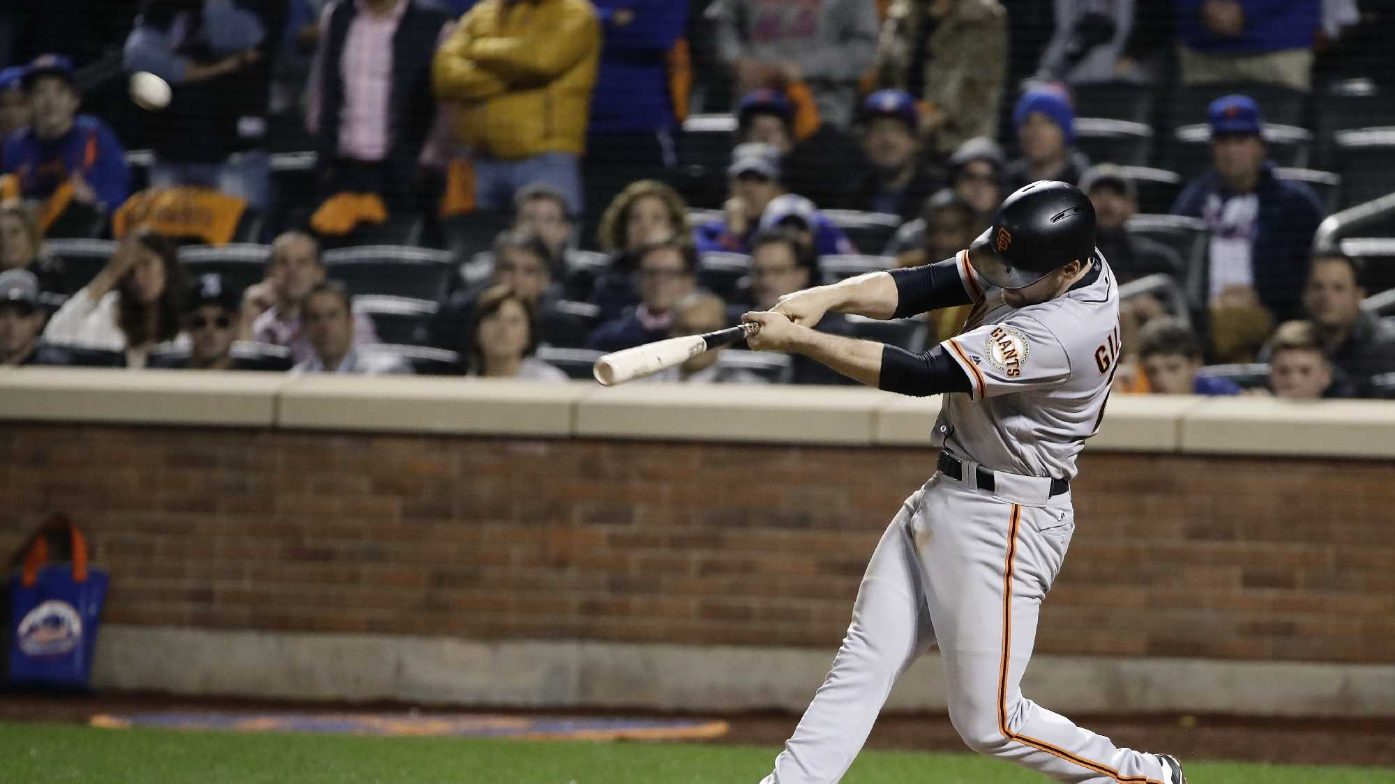 San Francisco Giants' Conor Gillaspie connects for a three-run home run against the San Francisco Giants during the ninth inning of the National League wild-card baseball game.