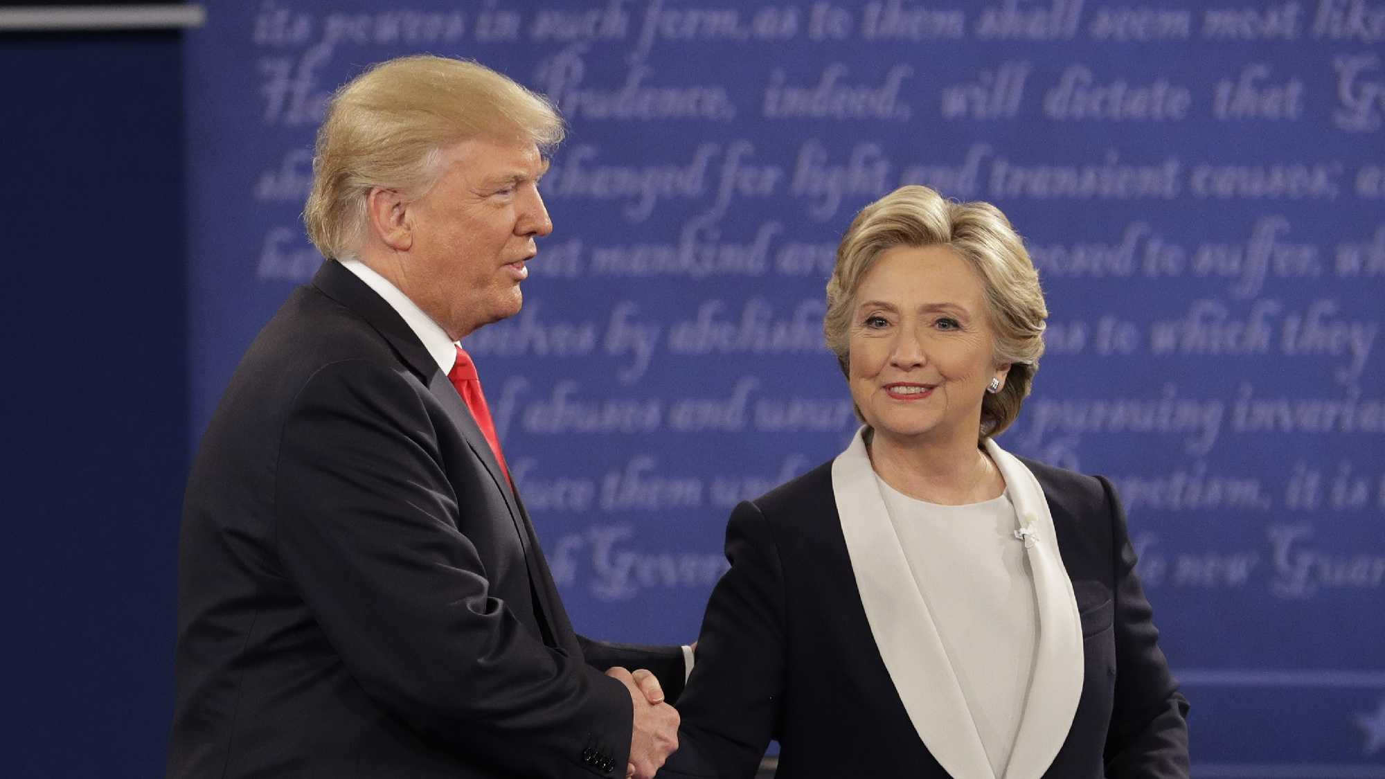 Republican presidential nominee Donald Trump shakes hands with Democratic presidential nominee Hillary Clinton during the second presidential debate at Washington University in St. Louis, Sunday, Oct. 9, 2016.