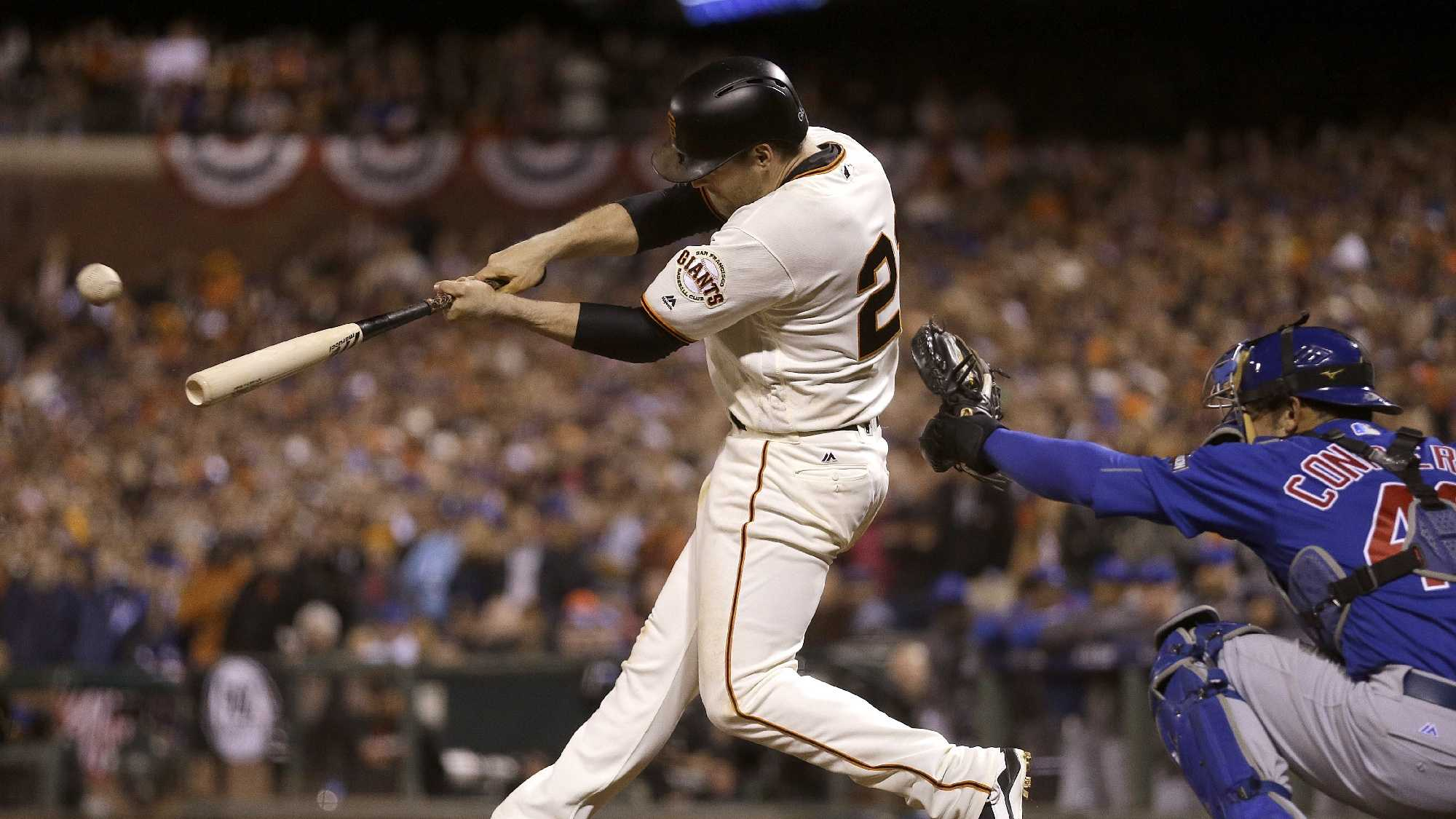 San Francisco Giants' Conor Gillaspie, left, hits a two-run triple in front of Chicago Cubs catcher Miguel Montero during the eighth inning of Game 3 of baseball's National League Division Series in San Francisco, Monday, Oct. 10, 2016.