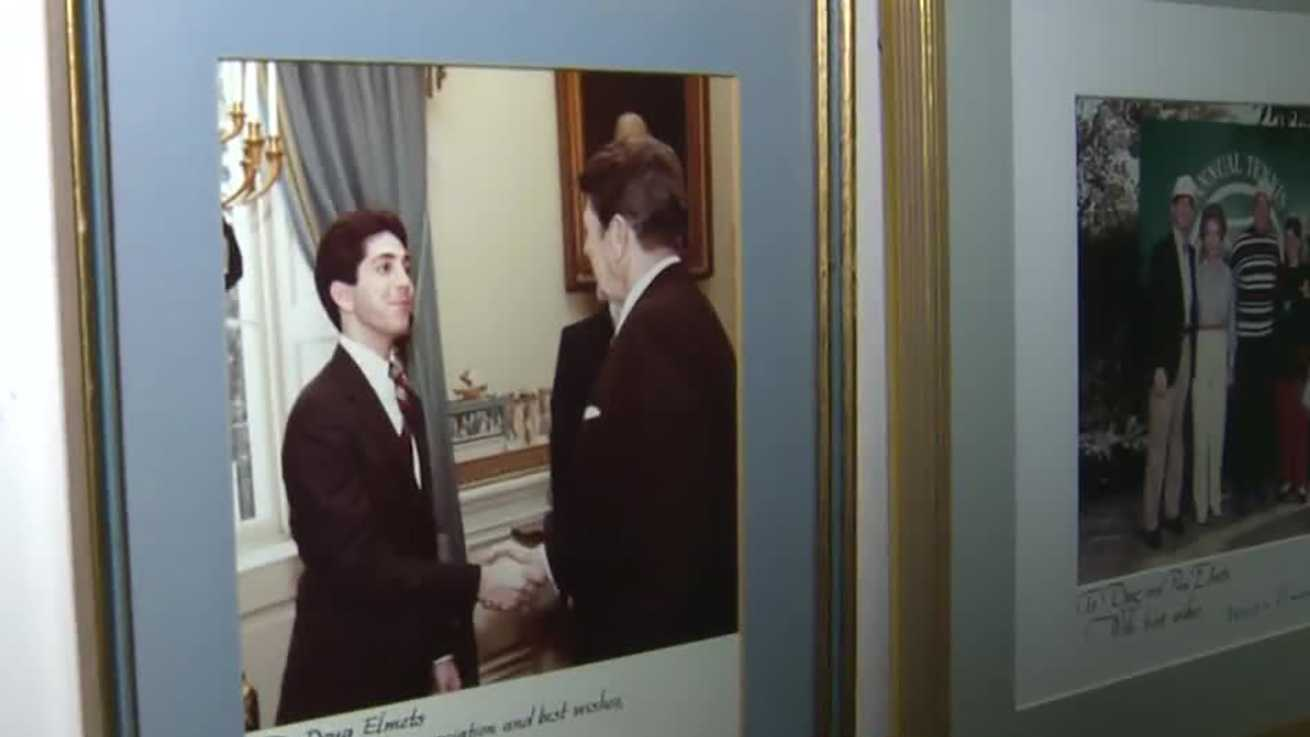 Photo hanging in Doug Elmets home shows him shaking hands with former President Ronald Reagan.