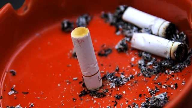 cigarettes in ash tray smoking