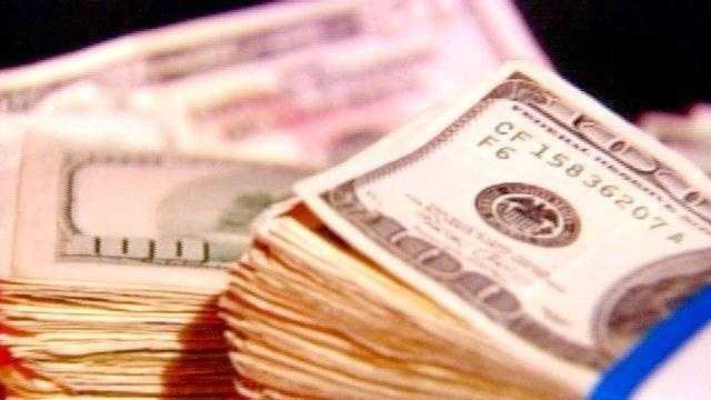 Money stacks of 100 dollars generic - 18785769
