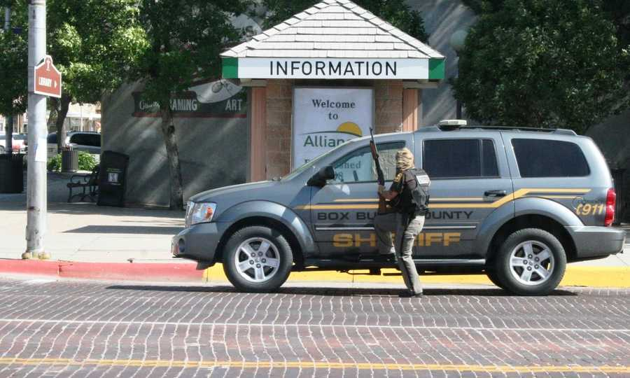 A Box Butte County Sheriff's deputy waits nearby.