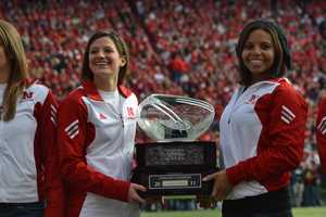 The Husker women's gymnastics team was honored before a game for winning the Big 12 championship the year before.