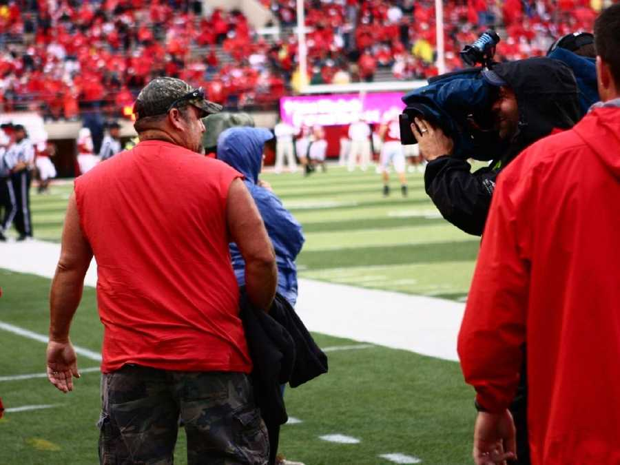 Larry the Cable Guy on the sidelines.