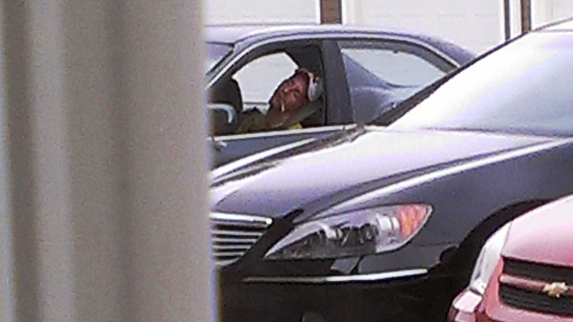 A witness took this picture of a the man sleeping in his car before a confrontation with a police officer.