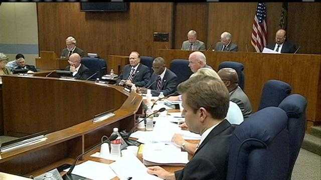 Omaha's City Council moves to roll back undisclosed pay raises handed out by Mayor Jim Suttle.
