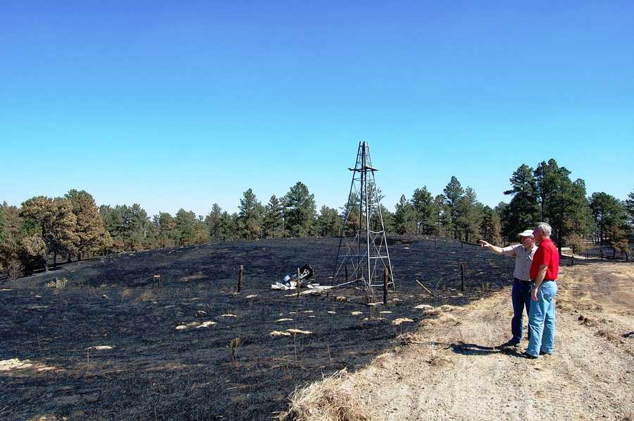 Gov. Dave Heineman surveys the destruction near Chadron.