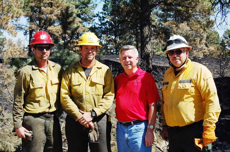 Gov. Dave Heineman with a crew near Chadron.