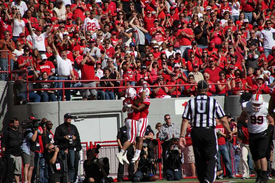 Rex Burkhead celebrates in the end zone after one of his touchdowns.