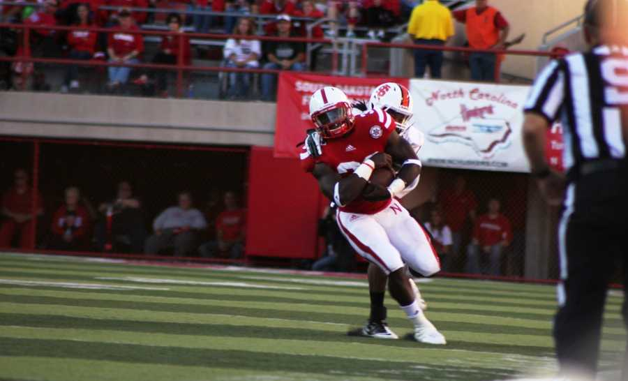 Imani Cross tries to go outside as he racks up more than 100 yards for the day.