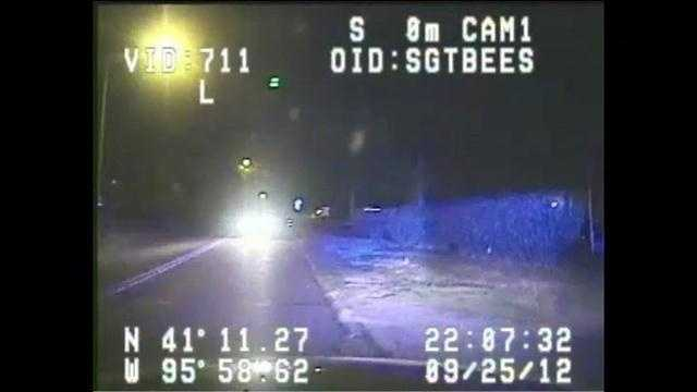 Dash cam video shows a car traveling toward a police cruiser at a high rate of speed.