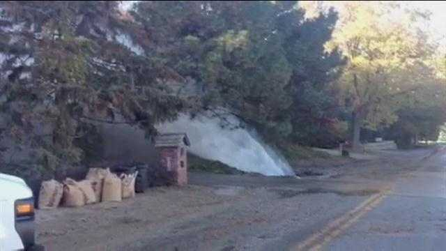 A house is getting very wet after a water main break creates a geyser in their front yard.